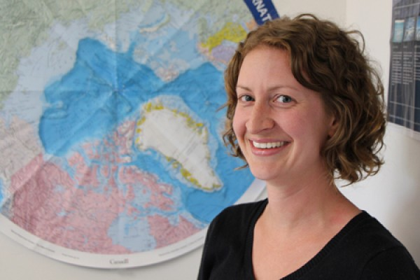 Melissa McKinney standing if front of map of North Pole