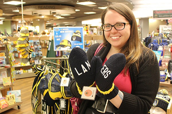 Meg Gregory shows off a pair of Lancers mittens