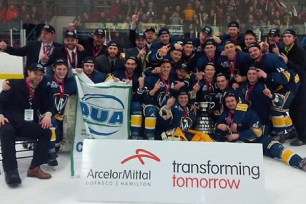 Lancer men's hockey team celebrates its OUA banner