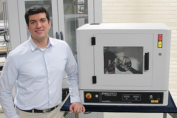 Nick Vukotic poses with Proto Manufacturing's benchtop powder X-ray diffraction system.