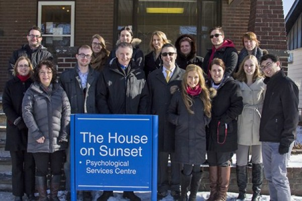 Students, faculty and staff of the House on Sunset turn out to welcome UWindsor president Alan Wildeman.