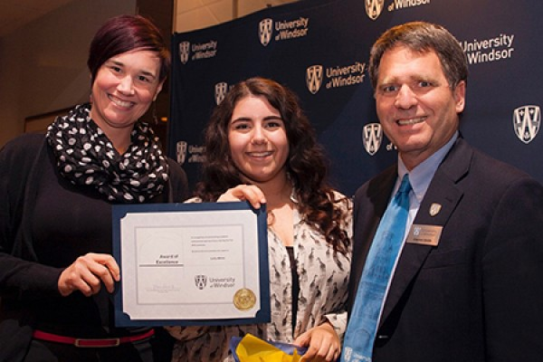 Leila White receives congratulations from dean of students Clayton Smith and Lynn Charron