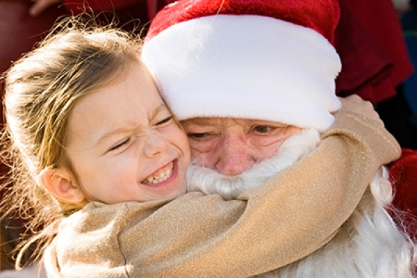 young girl hugging Santa