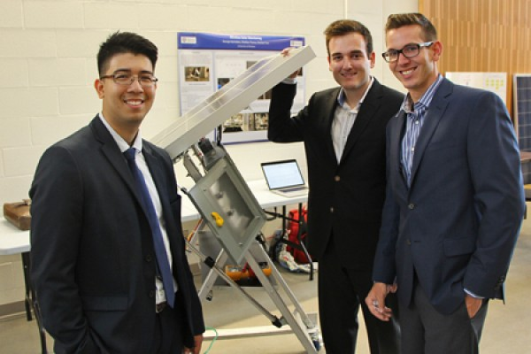 Shahab Tran, George Kyrtsakas and Sheldon Tracey pose with solar panel array.