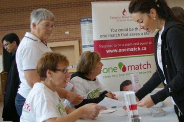 people lined up at One Match registration table