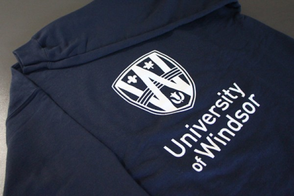 sweatshirt, imprinted with the UWindsor logo