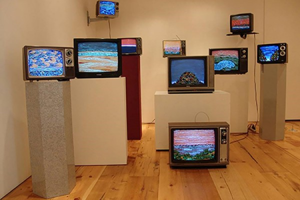television sets arranged artistically by Iain Baxter&