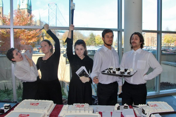 acing students cut cake with an axe