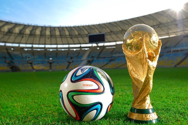 World Cup, soccer ball in stadium.