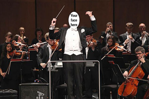 Faceless conductor standing before orchestra