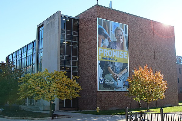 Essex Hall bearing large sign with slogan Promise