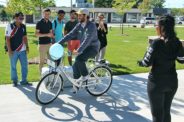 UWSA president Moussa Hamadani tries out a Zagster bike.