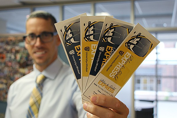 Ryan Flannagan holds tickets for the Blue and Gold Express