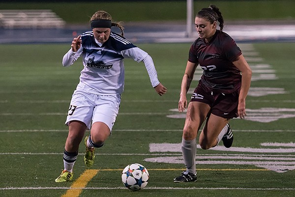 Rookie midfielder Chelsea Zavitz competes for the ball against Mac's Mary Craig.