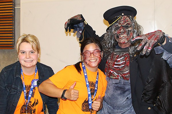 Katrina Hermle and Catherine Muldoon pose with undead fire chief Bruce Montone