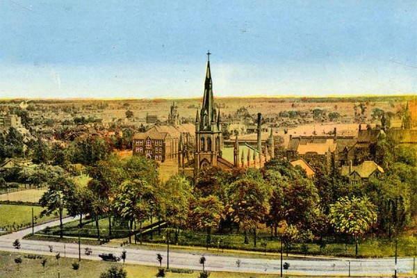 A picture postcard shows what Assumption Church and its neighbours looked like in 1924.