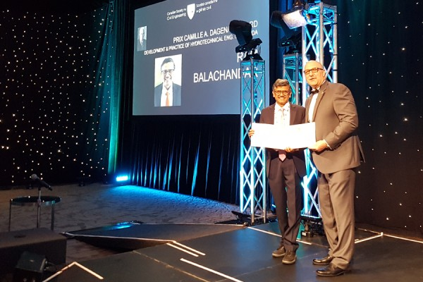Ram Balachandar (left) accepts the Camille A. Dagenais Award