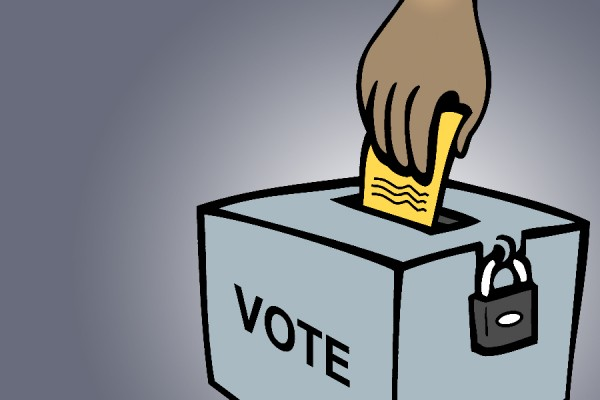 cartoon hand placing ballot in box