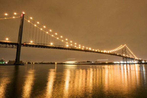 Ambassador Bridge lit up under night sky