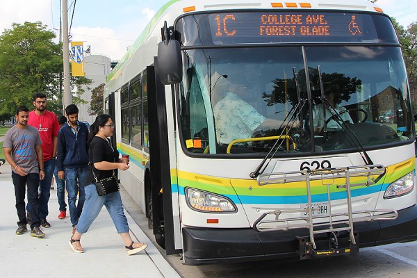 Passengers boarding bus at north end of main campus