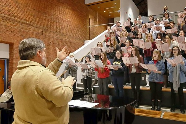 Choir director Bruce Kotowich leads a rehearsal