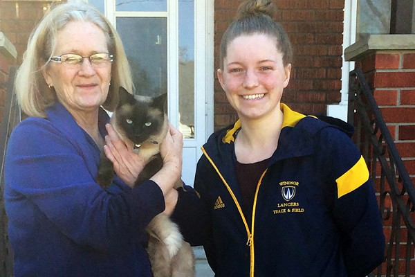 Marion Melville, her cat Rescue, student Charlene Rhead