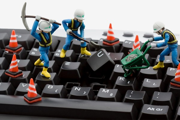toy workers digging up keyboard