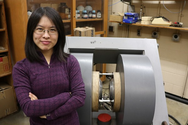 Physics professor Dan Xiao is experimenting with an electromagnet to develop a portable Magnetic Resonance device.
