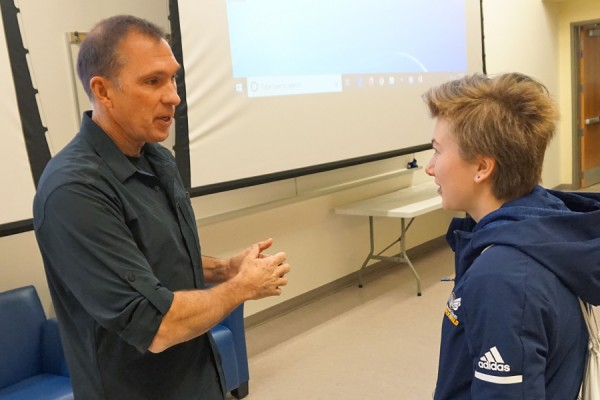Olympic decathlete Dave Steen gives Lancer long jumper Ashley Langelier a few pointers after speaking to her class in sports ethics.