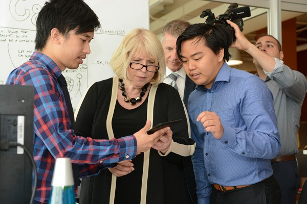 The young entrepreneurs Scott Nguyen (l.) and Jimmy Truong (r.) discussed an app they have created with Deputy Premier Deb Matthews (center), during her tour at the University's business incubator, the Entrepreneurship Practice and Innovation Centre.
