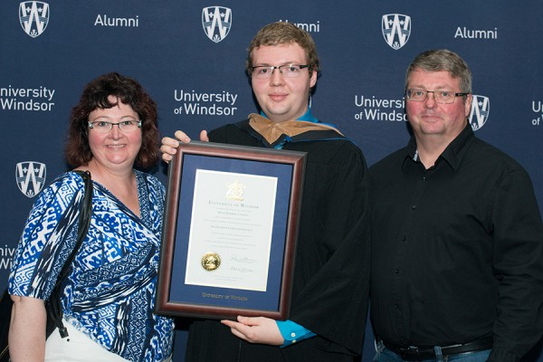 Ryan Lawson (centre) and his parents