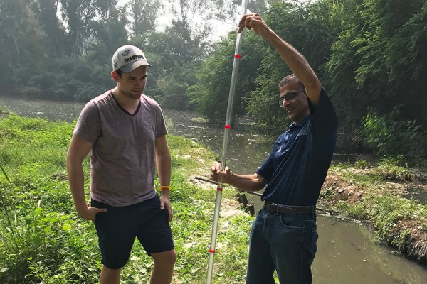 Dylan Verburg, a master's candidate in environmental engineering, and professor Rajesh Seth work to improve drinking water quality in the capital of India.
