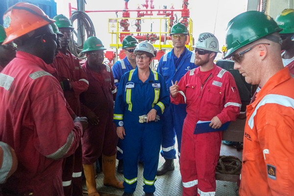 Pamela Nadin-McIntyre meets with a drilling team.