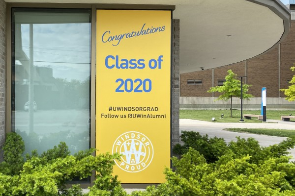 "decal reading ""Congratulations Graduates"" placed in window"