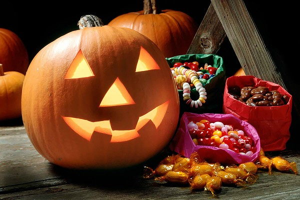 jack o'lantern and bags of candy