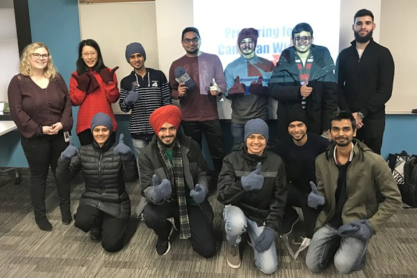 Nursing students Shae Driedger and Mohamad Bassam flank 10 international students who attended a session on how to prepare for a Canadian winter.