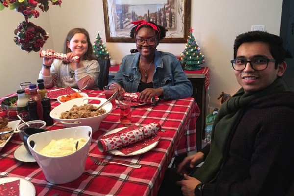 students joining family at dinner table