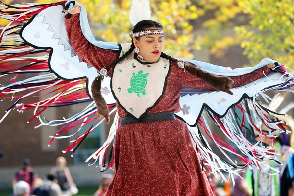 Student performing Indigenous dance
