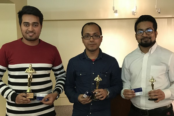 Tahir Chowdhry, Soham Mitra, and Gopal Kotwal hold awards statuettes