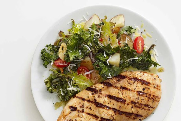 roasted kale and potatoes alongside grilled chicken