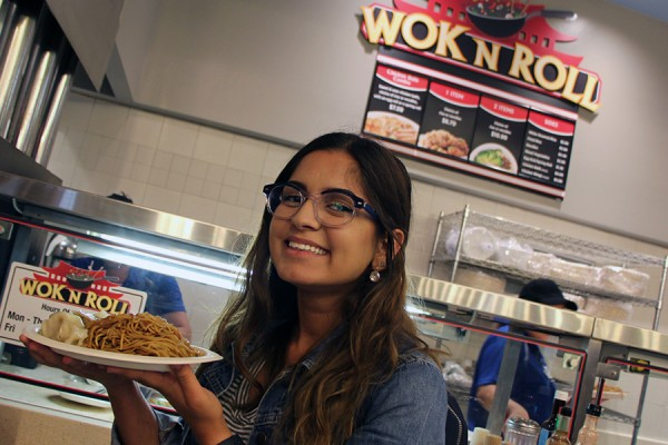 Law and politics student Katrina Bahnam looks forward to her lunch of vegetable pot stickers and lo mein from the Wok N Roll outlet in the Marketplace food court.
