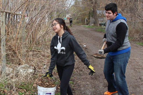 KimBui and RifaatSaid volunteers come out to ready the plot for spring planting.