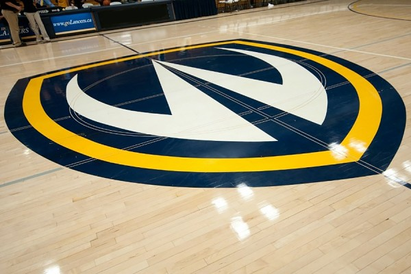 Lancer logo on floor of Dennis Fairall Fieldhouse