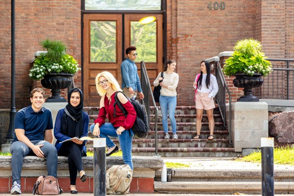 students posed outside Assumption Hall