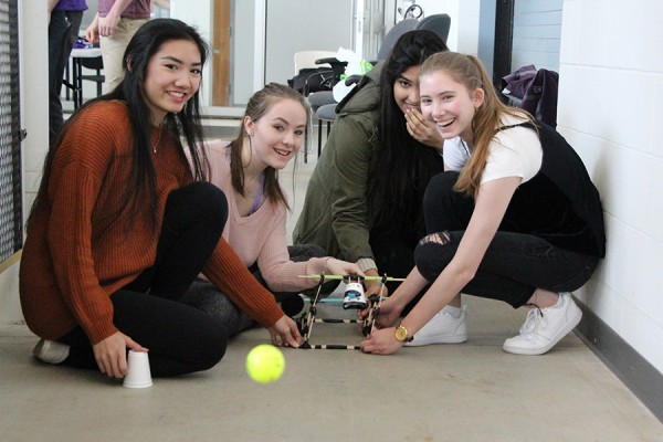 Mylene Tu, Jessica Doe, Aditi Kukreja and Franci Toth test their catapult