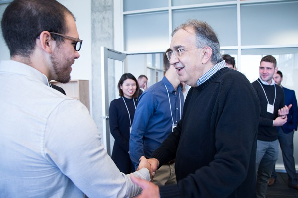 Sergio Marchionne shaking hands with a student