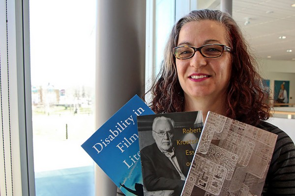 Nicole Markotić holds three of her four new books.