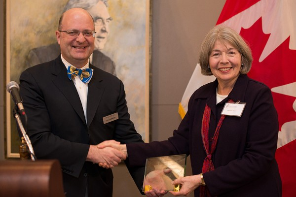 Chi Carmody, Canadian director of the Canada-United States Law Institute, presents the Sidney Picker Jr. Award to law professor emerita Maureen Irish.