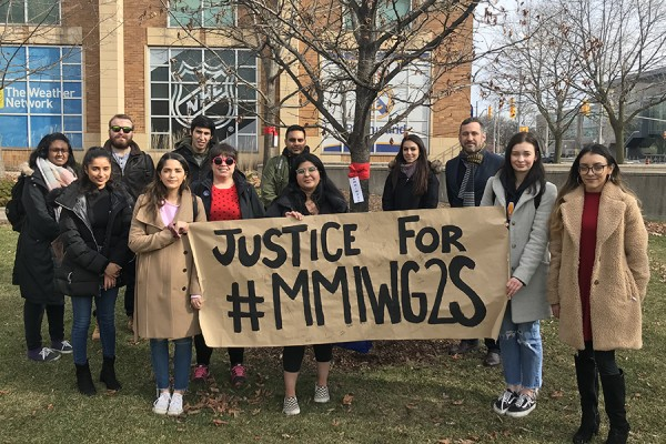 University of Windsor students stand with dean of law Christopher Waters in calling for justice for Missing and Murdered Indigenous Women, Girls, and Two-Spirit people.