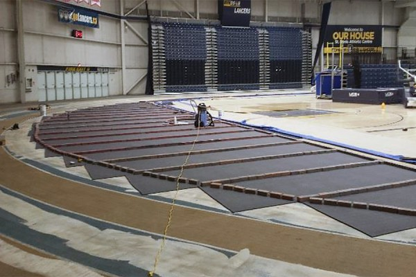 Brick pavers secure the new surface during the replacement of flooring in the Dennis Fairall Fieldhouse.
